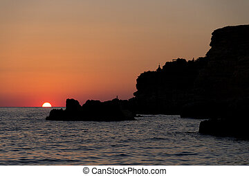 Enchanting golden sunset on beach