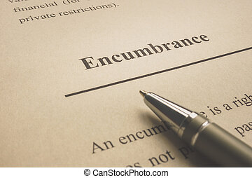 Encumbrance word on the page with pen.
