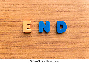 end colorful word on the wooden background