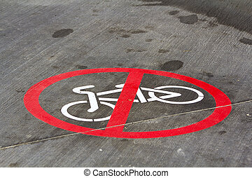 End of bicycle lane sign on the asphalt road surface