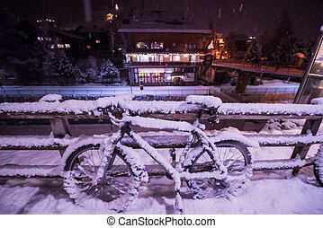 parked bicycle covered by snow