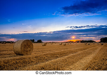 End of day over field with hay bale in Hungary- This photo ...