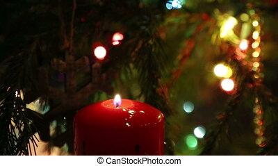 end of holiday - candle goes out and Christmas lights are switched off