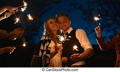 End of the wedding day. Many sparkles around couple.