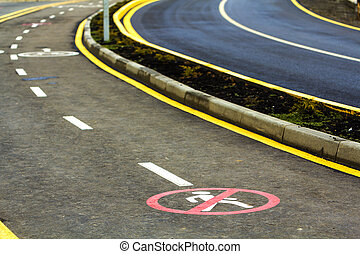 End of walk way sign on the asphalt road surface