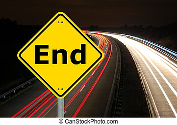 end written on a yellow road sign and copyspace for text...