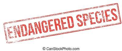Endangered species red rubber stamp on white. Print, impress, overprint.
