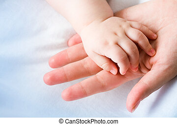 Endearment - Image of mom?s palm with newborn baby hand on...