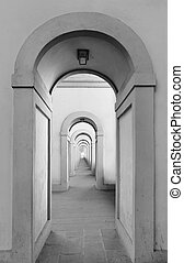 Endless arched doorways repeating to infinity.