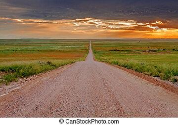 Endless Dirt Road on Prairie