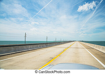 Endless empty road by the ocean in a great car. Endless road. Atlantic intracoastal and highway us1. Florida Keys interstate.