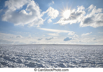 Endless field of snow and sunny sky
