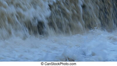 Endless stream of falling water - Endless raging stream of...