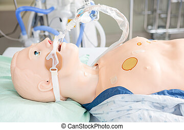 Endotracheal tube attached to dummy patient in hospital room