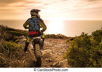 Enduro bike rider - Enduro racer sitting on his motorcycle...