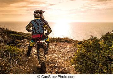 Enduro bike rider - Enduro racer sitting on his motorcycle...