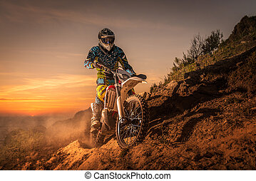 Enduro bike rider - enduro rider climbing a high slope...