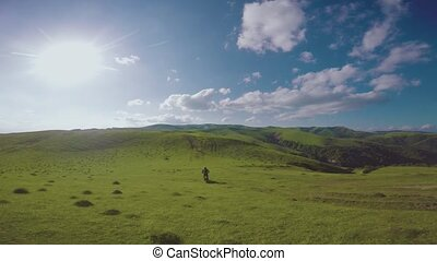 Enduro journey with dirt bike high in the Caucasian mountains, hills, valleys