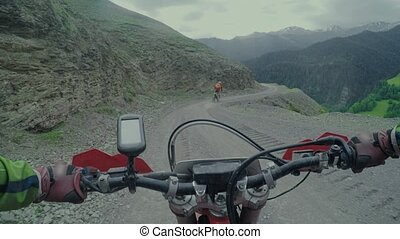 Enduro journey with dirt bike high in the Caucasian...