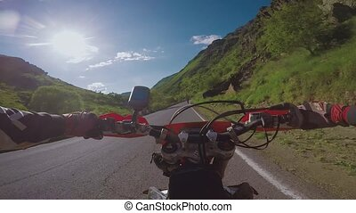 Enduro journey with dirt bike on th road high in the Caucasian mountains, hills, valleys