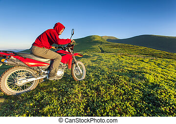Enduro motorcycle riding in the mountains