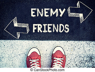 Enemy and friends - Student standing above the sign enemy...