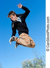 Energetic boy jumping.