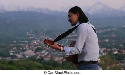 Energetic businessman playing the guitar and singing