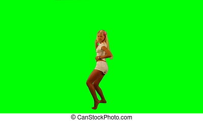 Energetic dance - Young female dancer over green background