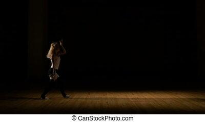 Energetic dancer performing acrobatic dance sequence