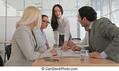 Energetic discussion - Energetic business team arguing over...