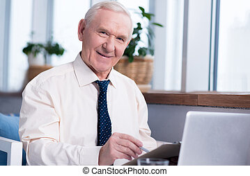 Energetic elderly executive studying documents