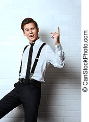 energetic - Imposing young man in elegant suit posing by...