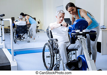 Energetic man in wheelchair training in a rehabilitation center