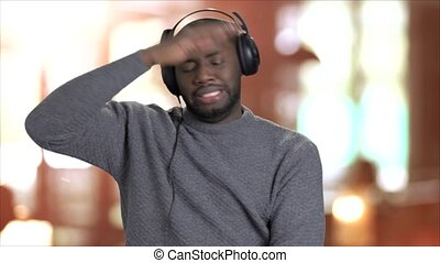 Energetic man listening to music in headphones.