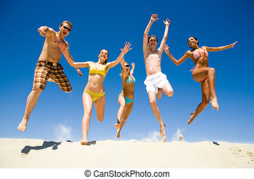 Energetic people - Image of five energetic people jumping at...