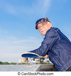 energetic senior man enjoying riding a skateboard