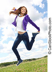 Energetic teenager - Cute girl in casual clothes jumping...