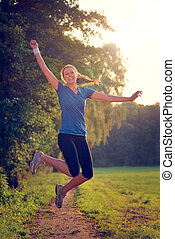 Energetic woman leaping in the air