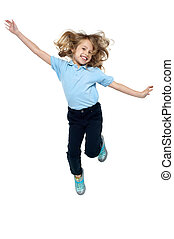 Energetic young child jumping high - Beautiful girl child...