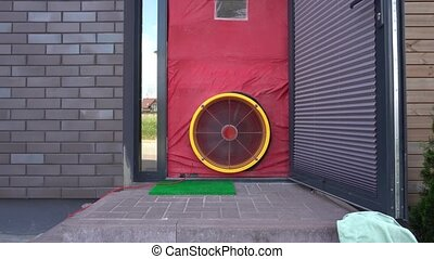 Energy audit with blower door test fan. Gimbal movement -...