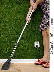 energy concept of a woman with a vacuum cleaner