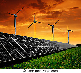 energy concept - Solar energy panels with wind turbines in...