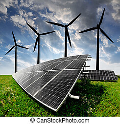 energy concept - solar energy panels and wind turbine