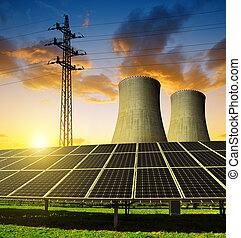 Solar energy panels, nuclear power plant and electricity pylon at sunset.
