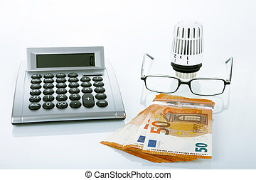 Energy Costs - Calculator and thermostat with eyeglasses on...