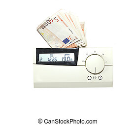 Energy costs - Euro bills behind the thermostat of the...