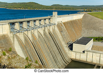 Energy Dam at a lake - Energy producing power station on a ...