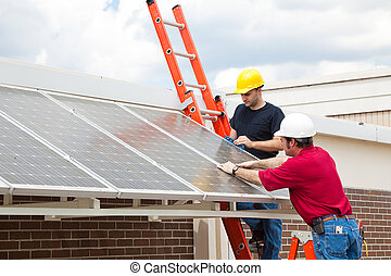 Energy Efficient Solar Panels - Workers install energy...