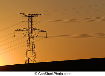 electric pylon on sunset background